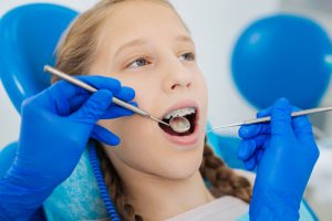 Girl with braces having a dental or orthodontic examination
