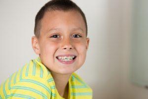 A young boy that has braces