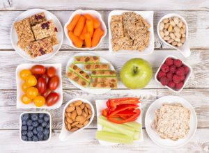 Many bowls of healthy snacks that children can enjoy.