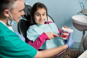 dentist with a young girl patient