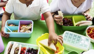 Kids eating health lunches at elementary school