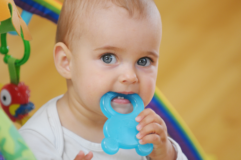 Baby chewing on a teething toy