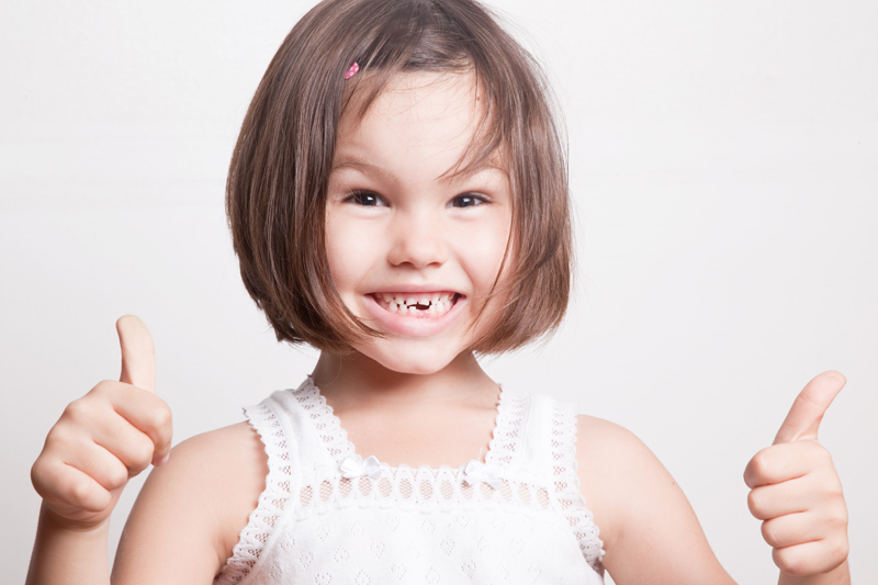 Losing Baby Teeth--What to Expect and Do